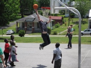 So close to dunking at a party in the park