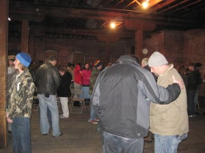 Praying at our Warehouse Worship in 2011.