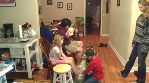 Some of the kids at Sunday night worship/prayers washing feet