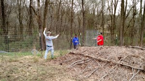 Mission Madness folks adding fence to the chicken run on the Urban Farm
