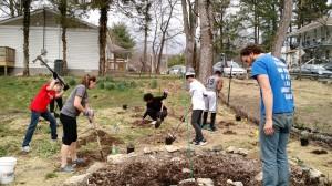 Mission Madness folks planting things at the Urban Farm