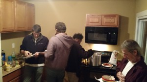 Getting food at a small party at the new community house (donated by Ascension Lutheran Church)