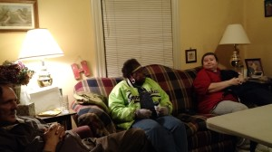 Some of the folks gathered for a meal in a home
