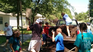 Passport campers unloading compost at the Urban Farm