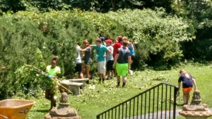 Passport Campers clearing vines from bushes at a partner church