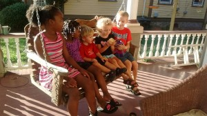 Some of the kids sharing a porch swing before evening prayers.