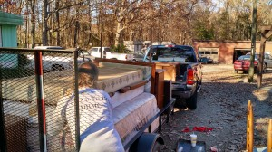 Trailer loaded up with donated furniture, there's still room in the bed of the pickup