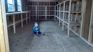 The inside of the new tool library (before any tools) with a 3 year old for scale